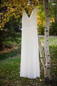 colorado-wedding-photographer, silverthorne-wedding, fall-colorado-wedding, bride-getting-ready, wedding-photography, happy-bride-and-groom, couple-in-love, wedding-dress, photo-of-wedding-dress