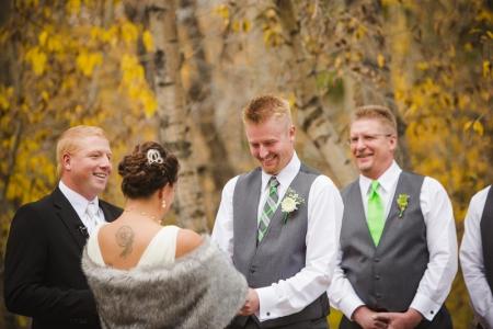 outdoor-ceremony-images, bride-and-groom, fall-wedding-colorado, colorado-wedding-photographer, silverthorne-wedding-photos, silverthorne-pavillion, mountain-wedding-colorado, photojournalism, candid-photos, laughter
