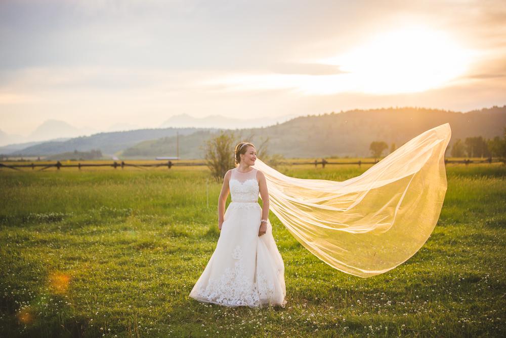 ranch-wedding, bride-groom-horses, grand-tetons-wedding, mountain-wedding, mountain-wedding-photography, colorado-wedding-photographer, rustic-ranch-wedding, bride-veil-sunset-photo